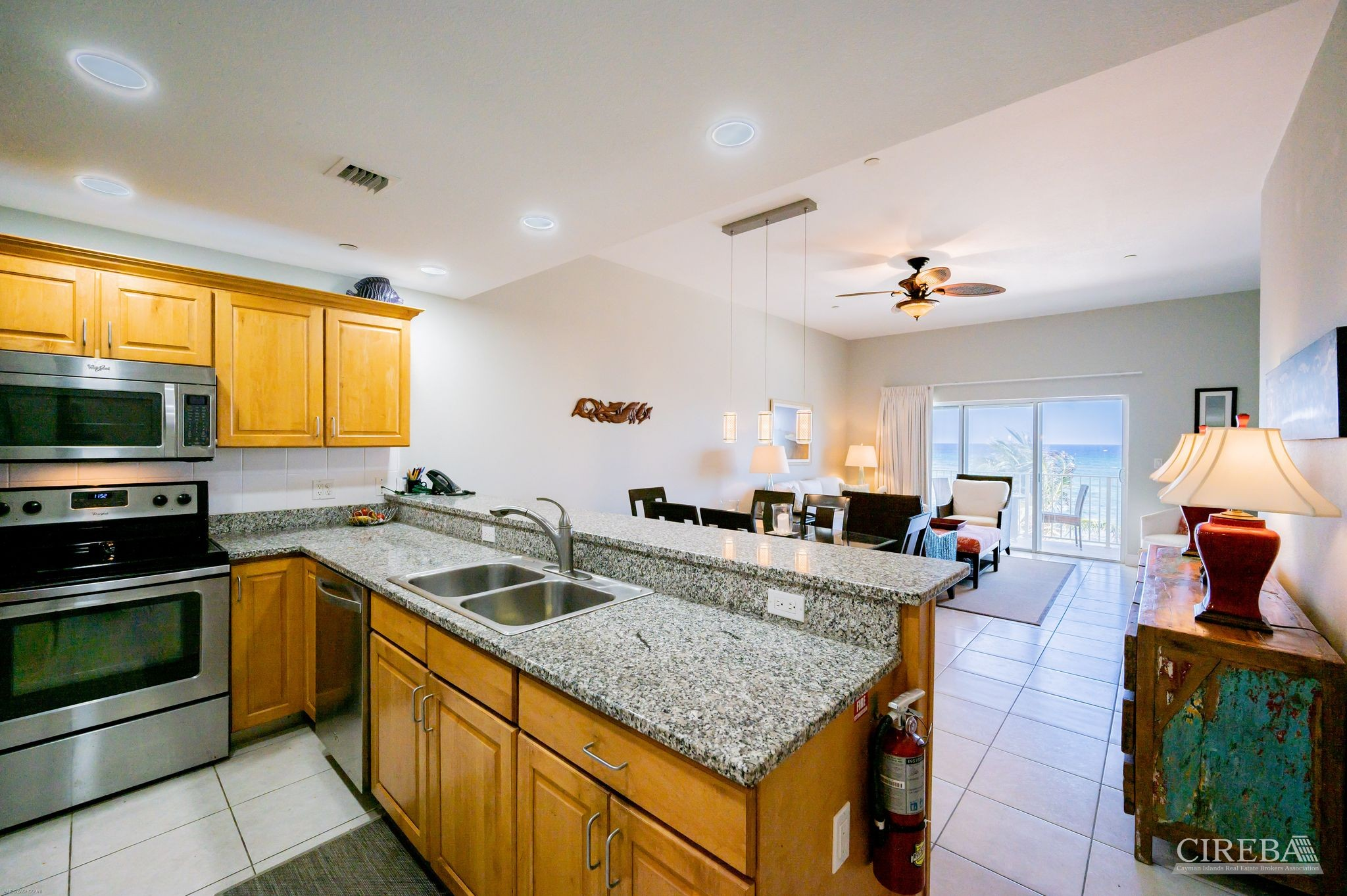 Granite countertops, stainless steel appliances, tastefully decorated throughout.