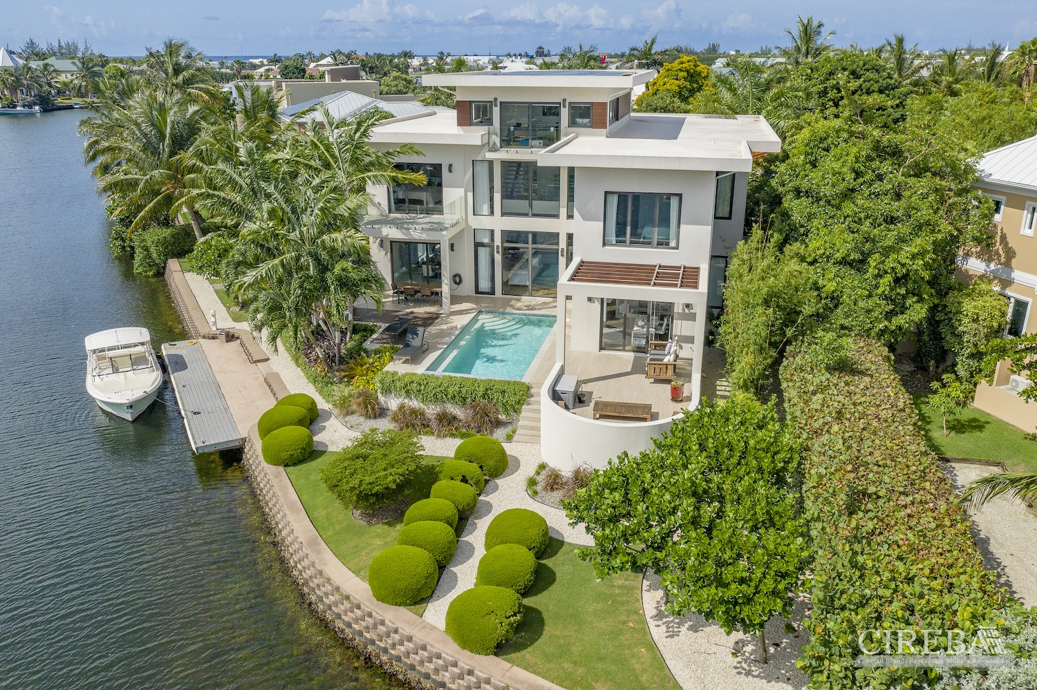 ARIAL VIEW OF HOUSE AND LANDSCAPED GARDENS