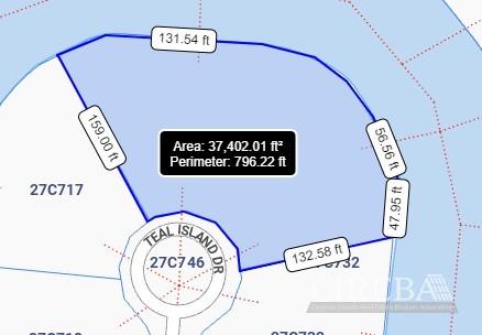 SAILFISH QUAY CANAL LOT .85 ACRES