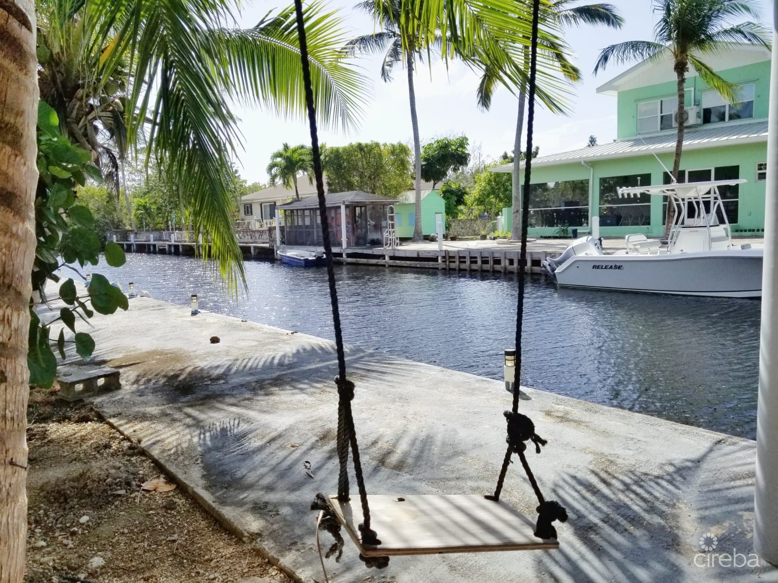 CANAL FRONT HOUSE WITH 100FT DOCK & INCOME PRODUCTING APARTMENT