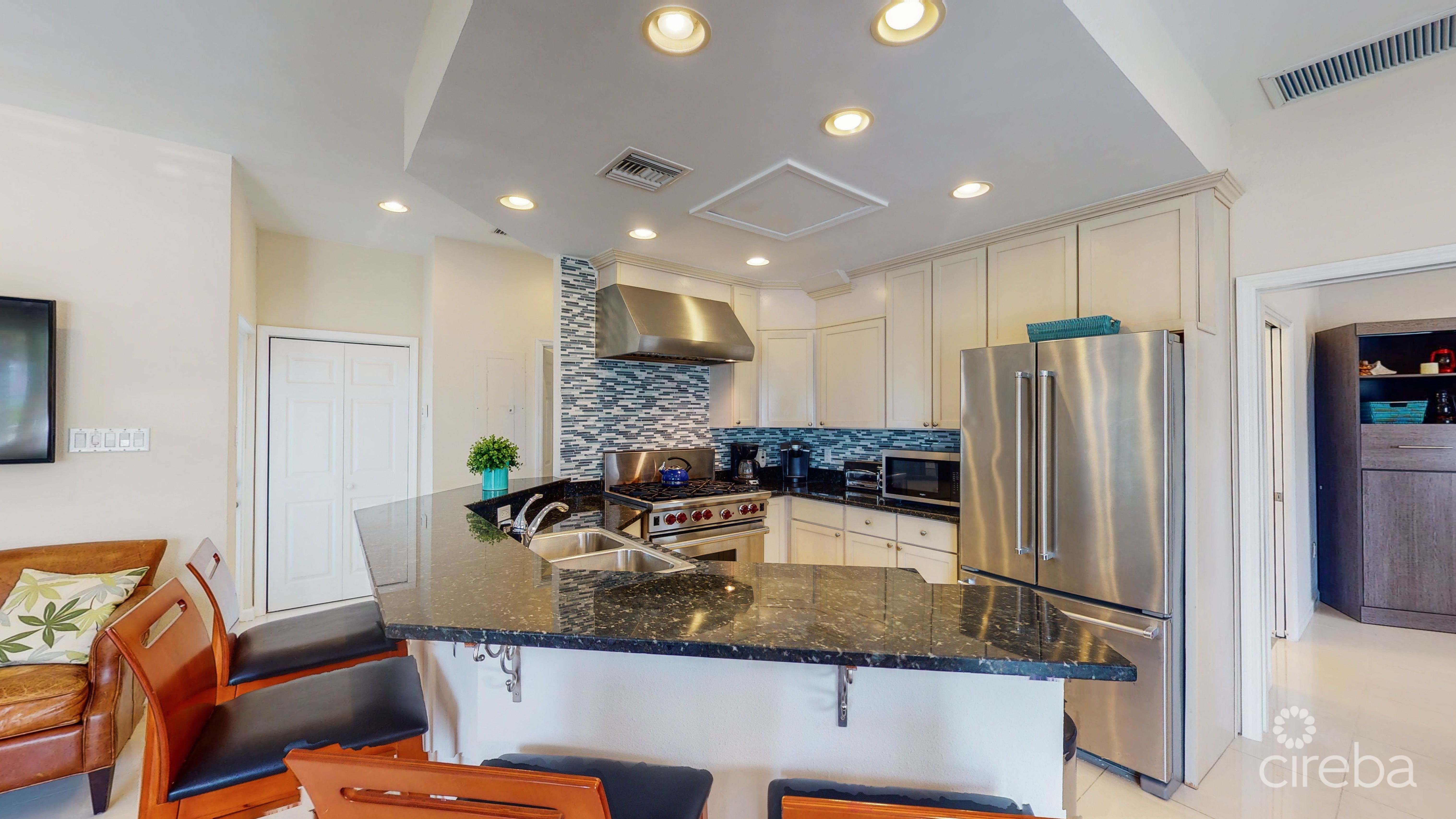 Eat in bar around the kitchen. Perfect for cooking and enjoying family time.
