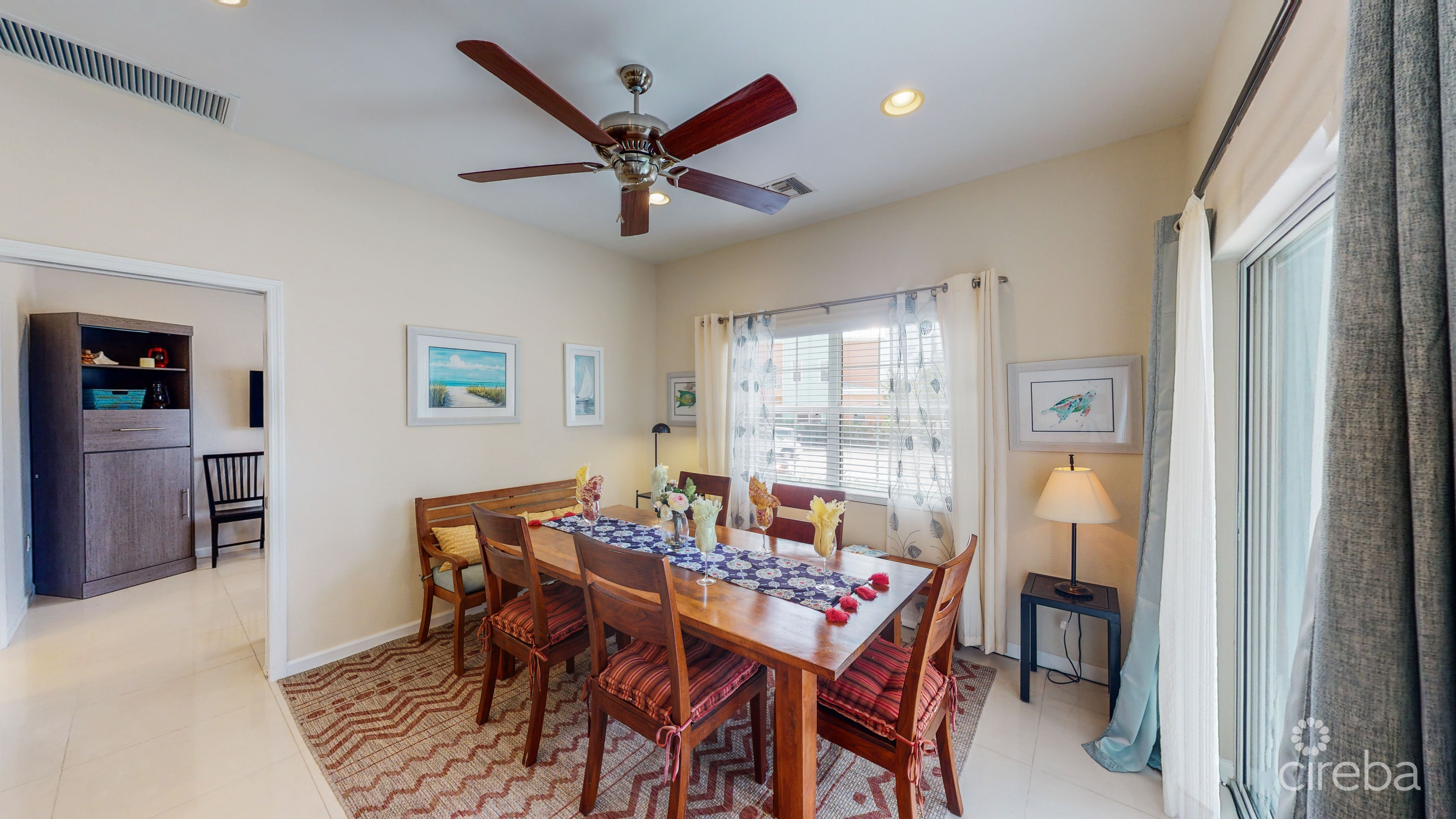 Open concept dining area with large hardwood table. views of the sea from the dining, kitchen, and living room!