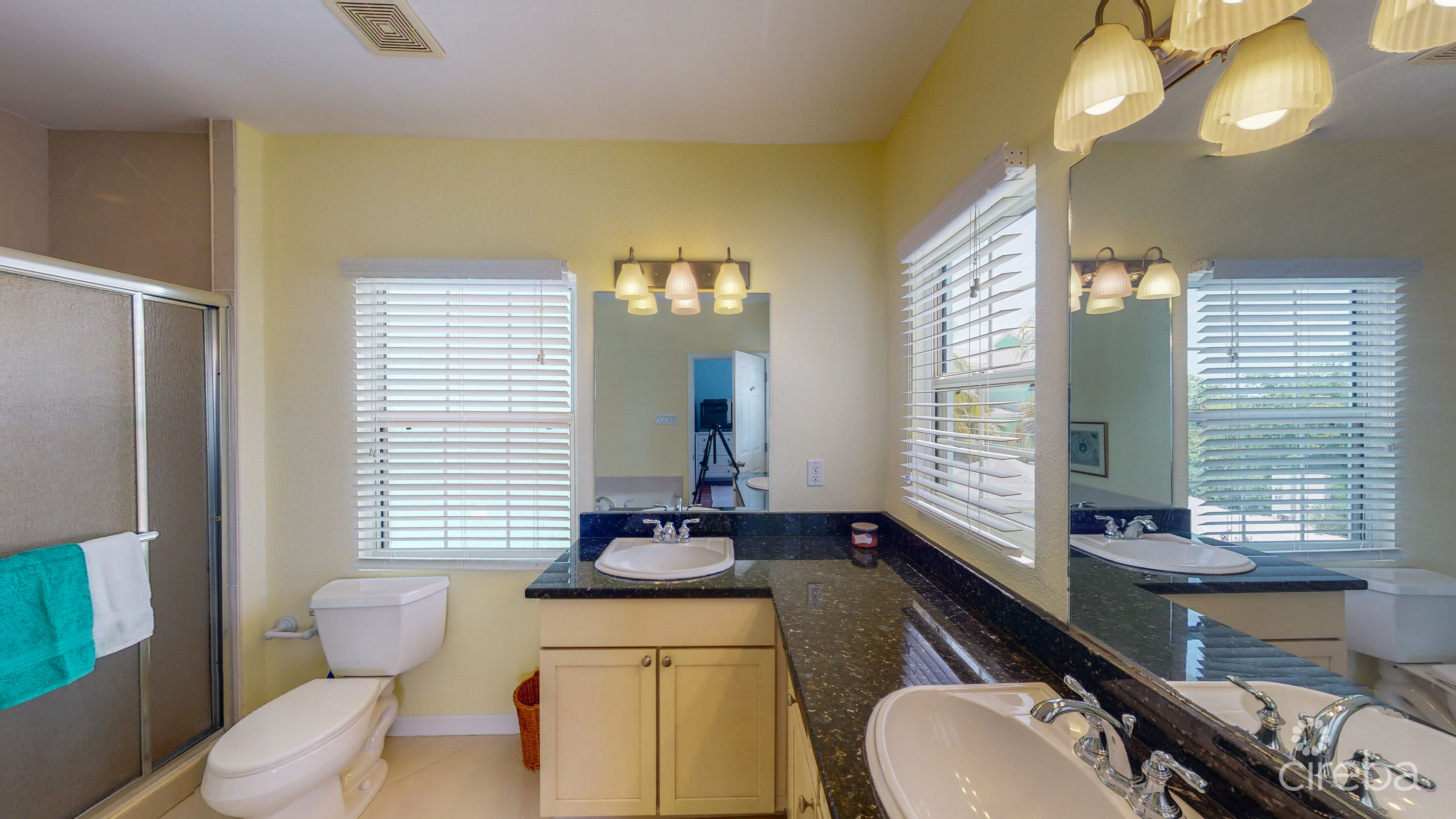 Ensuite master bathroom with  His and her vanity, shower, and soaking tub.