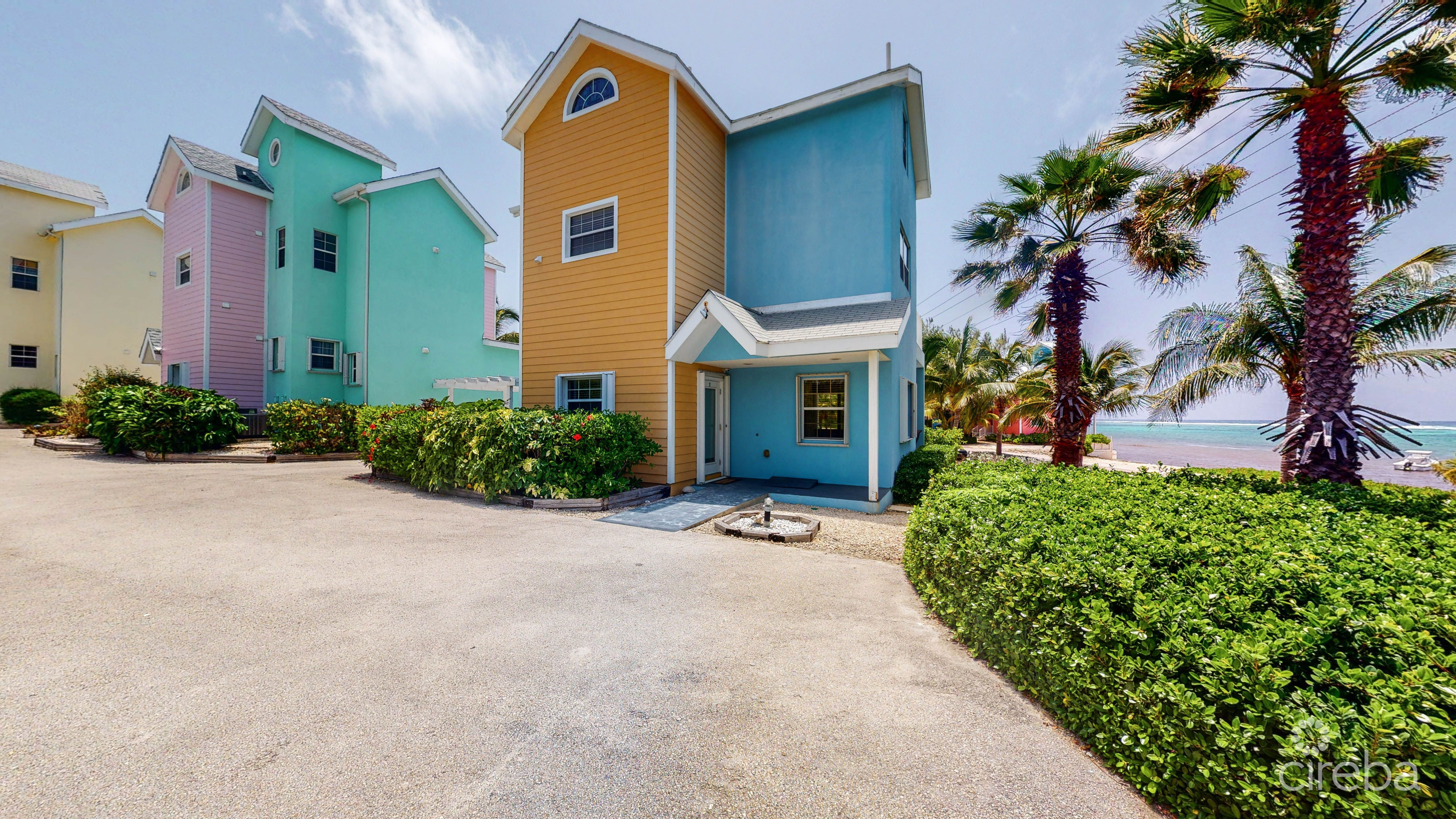 TONS of parking. This unit has space for two spots next to the newly added wheel chair ramp. another parking spot under a carport plus more visitor parking conveniently located in the front of Paradise Villas. Note the gorgeous sea view!
