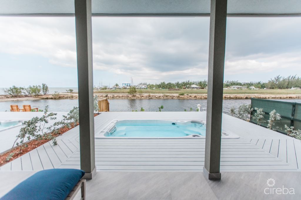 Private pool with swim spa jets and 30 foot boat dock