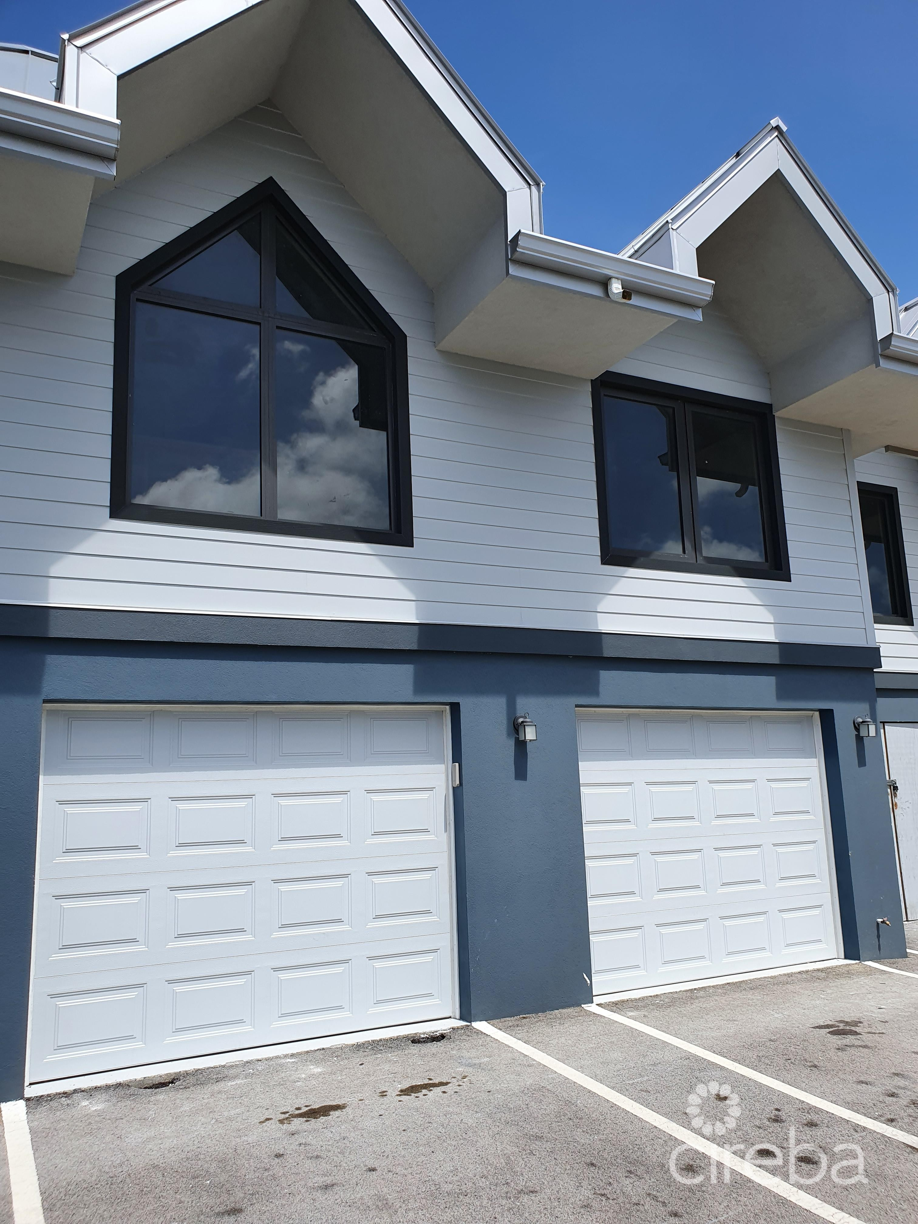 1 car garage with detached Carriage House above